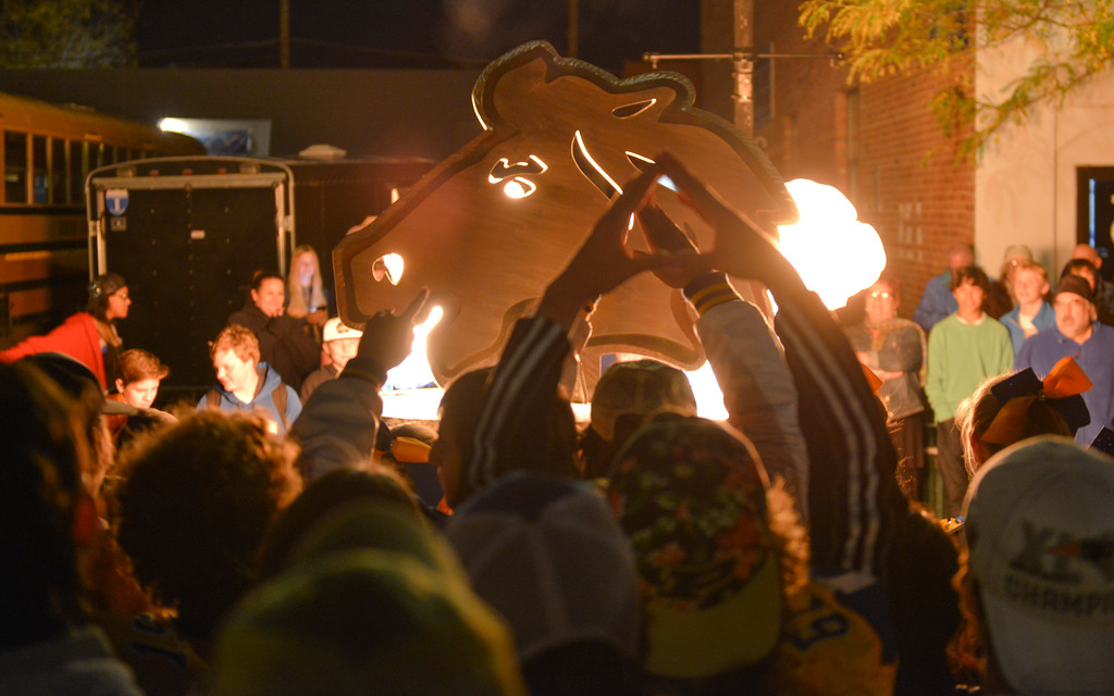 Justin Sheely | The Sheridan Press<br /> Students watch the burning of the Bronc Head during Sheridan High School's Homecoming downtown Pep Rally Thursday night on Grinnell Plaza. The Sheridan Broncs play Cheyenne Central on senior night Friday at 6 p.m. at Homer Scott Field.