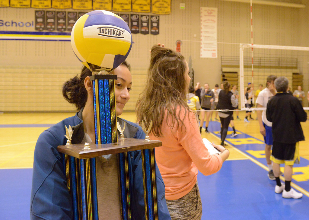 Justin Sheely | The Sheridan Press<br /> Lady Broncs volleyball player Mindy Songer carries a makeshift trophy prior to He-Man Volleyball in celebration for homecoming week Tuesday at Sheridan High School. High school boys competed in their class and against the school faculty in volleyball matches. The SHS downtown pep rally is Thursday at Grinnell Plaza beginning at 7 p.m.