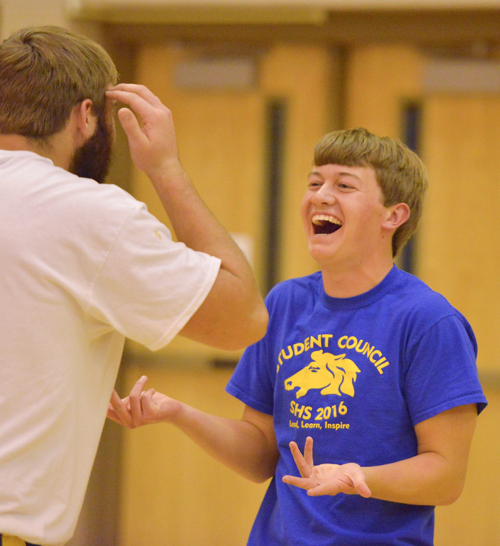 Justin Sheely | The Sheridan Press<br /> Kirby Coe-Kirkham, a junior, shrugs after touching a ball going out during He-Man Volleyball for homecoming week Tuesday at Sheridan High School. High school boys competed in their class and against the school faculty in volleyball matches. The SHS downtown pep rally is Thursday at Grinnell Plaza beginning at 7 p.m.
