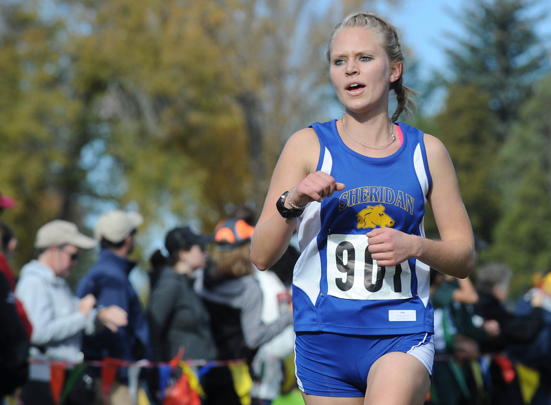 Mike Dunn | The Sheridan Press<br /> Sheridan's Laura Alicke approaches the finish line during the class 4A girls State Cross-Country Championship Saturday at the Veterans Affairs Medical Campus in Sheridan.