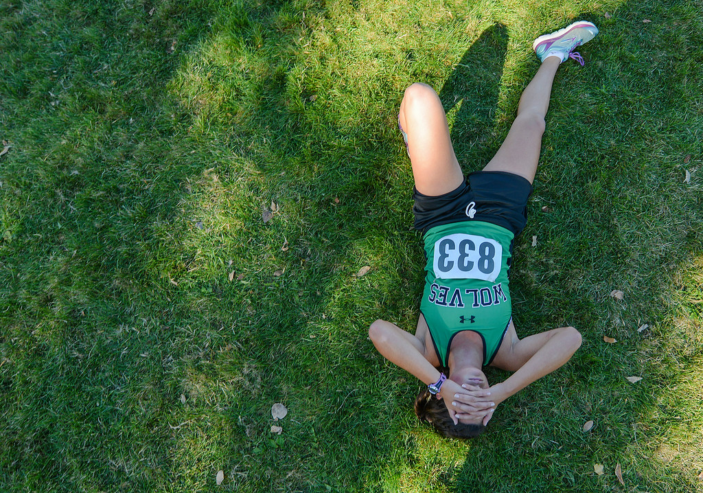 Justin Sheely | The Sheridan Press<br /> Moorcroft High School's Hailey Jones rests on the grass after winning the Class 2A girls State Cross-Country Championship Saturday at the Veterans Affairs Medical Campus in Sheridan.