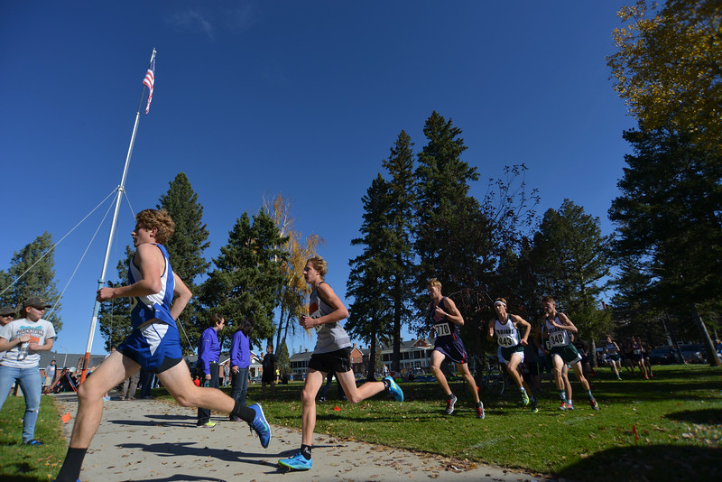 Justin Sheely | The Sheridan Press<br /> Runners go past the flagpole during the Class 4A boys State Cross-Country Championship Saturday at the Veterans Affairs Medical Campus in Sheridan.