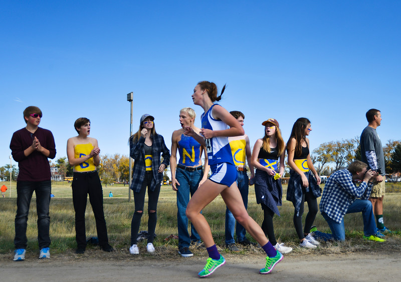 Justin Sheely | The Sheridan Press<br /> Sheridan High School students cheer on Josie Fettig during the class 4A girls State Cross-Country Championship Saturday at the Veterans Affairs Medical Campus in Sheridan.