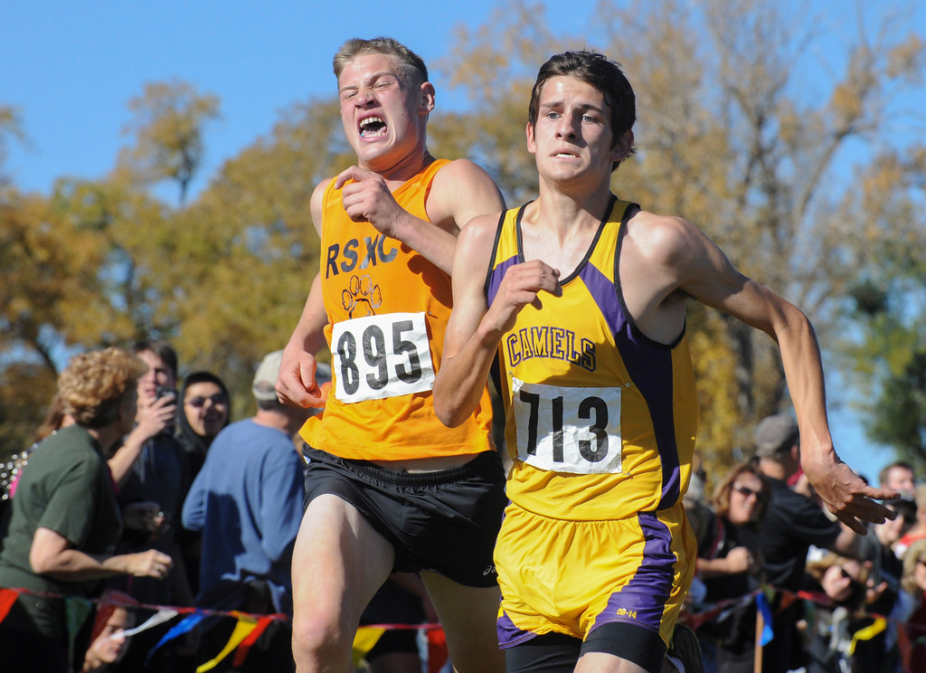 Mike Dunn | The Sheridan Press<br /> Rock Springs High School's Parker Jones, left, and Campbell County High School's Tristan Knottnerus compete in the class 4A boys State-Cross Country Championship Saturday at the Veterans Affairs Medical Campus in Sheridan.