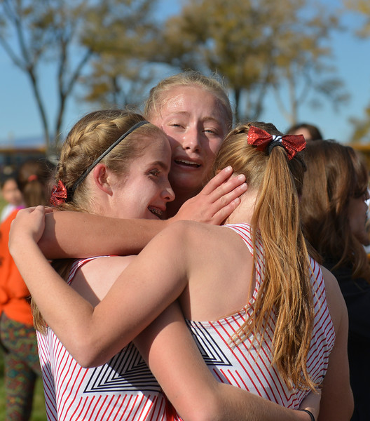 Justin Sheely | The Sheridan Press<br /> Cheyenne Central runners, from left, Claudia Miller, Sarah Krysl and Emma Brownell embrace after competing in the class 4A girls State Cross-Country Championship Saturday at the Veterans Affairs Medical Campus in Sheridan.