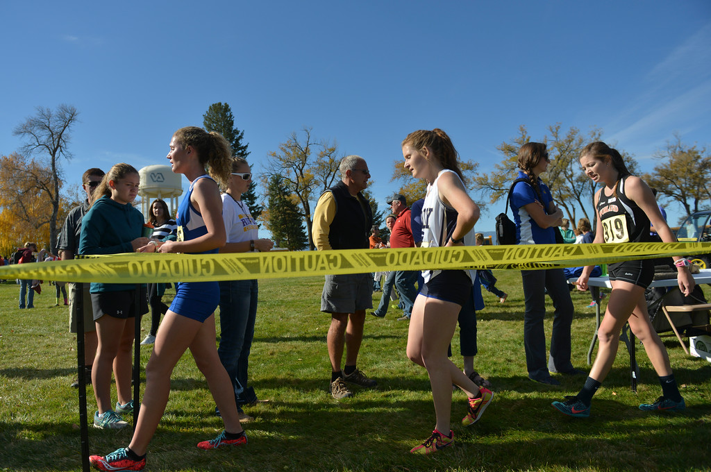 Justin Sheely | The Sheridan Press<br /> Runners walk up the line in the order they crossed the finish line during the Class 3A girls State Cross-Country Championship Saturday at the Veterans Affairs Medical Campus in Sheridan.