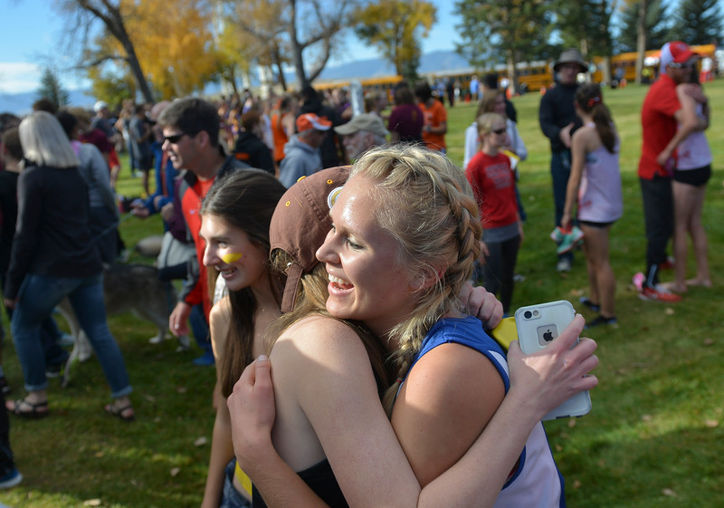 Justin Sheely | The Sheridan Press<br /> Sheridan's Laura Alicke is congratulated by teammates after finishing in the class 4A girls State Cross-Country Championship Saturday at the Veterans Affairs Medical Campus in Sheridan.
