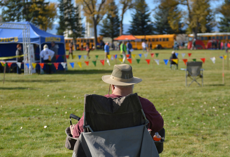 Justin Sheely | The Sheridan Press<br /> A fan stakes his spot prior to the first race during the State Cross-Country Championship Saturday at the Veterans Affairs Medical Campus in Sheridan.