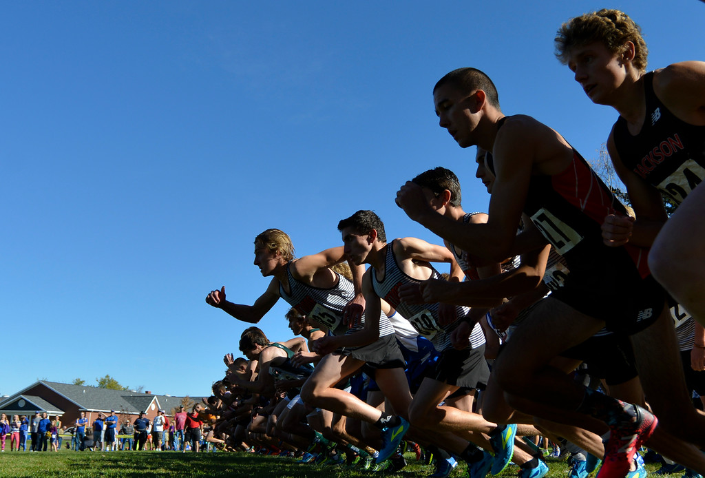 Justin Sheely | The Sheridan Press<br /> Runners launch from the starting line for the Class 4A boys State Cross-Country Championship Saturday at the Veterans Affairs Medical Campus in Sheridan.