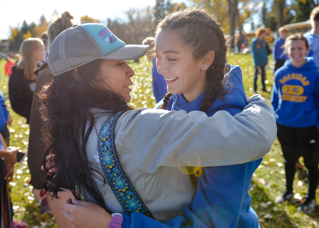 Justin Sheely | The Sheridan Press<br /> Carmen Robinson hugs her daughter, Sheridan senior Xiomara Robinson, during the State Cross-Country Championship Saturday at the Veterans Affairs Medical Campus in Sheridan.