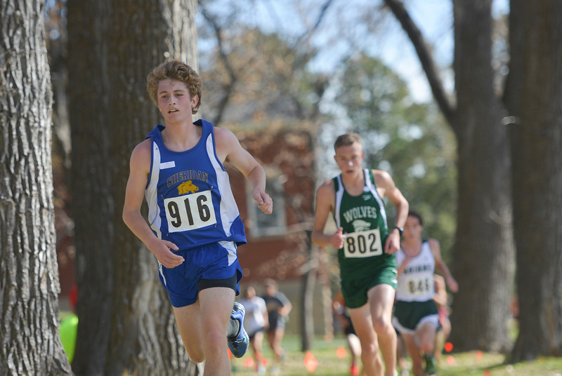 Justin Sheely | The Sheridan Press<br /> Sheridan's Brian Gonda runs under the trees during the Class 4A boys State Cross-Country Championship Saturday at the Veterans Affairs Medical Campus in Sheridan.