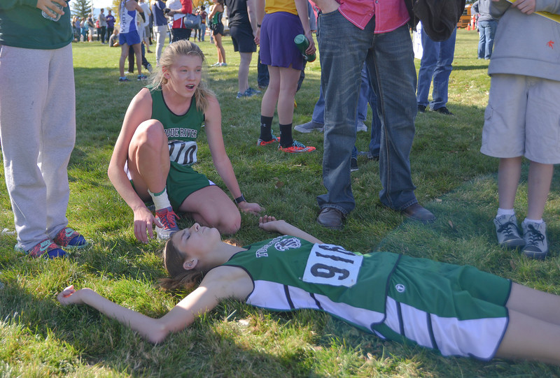 Justin Sheely | The Sheridan Press<br /> Tongue River's Kalie Bocek, left, and Macey McArthur rest after finishing the Class 2A girls State Cross-Country Championship Saturday at the Veterans Affairs Medical Campus in Sheridan.