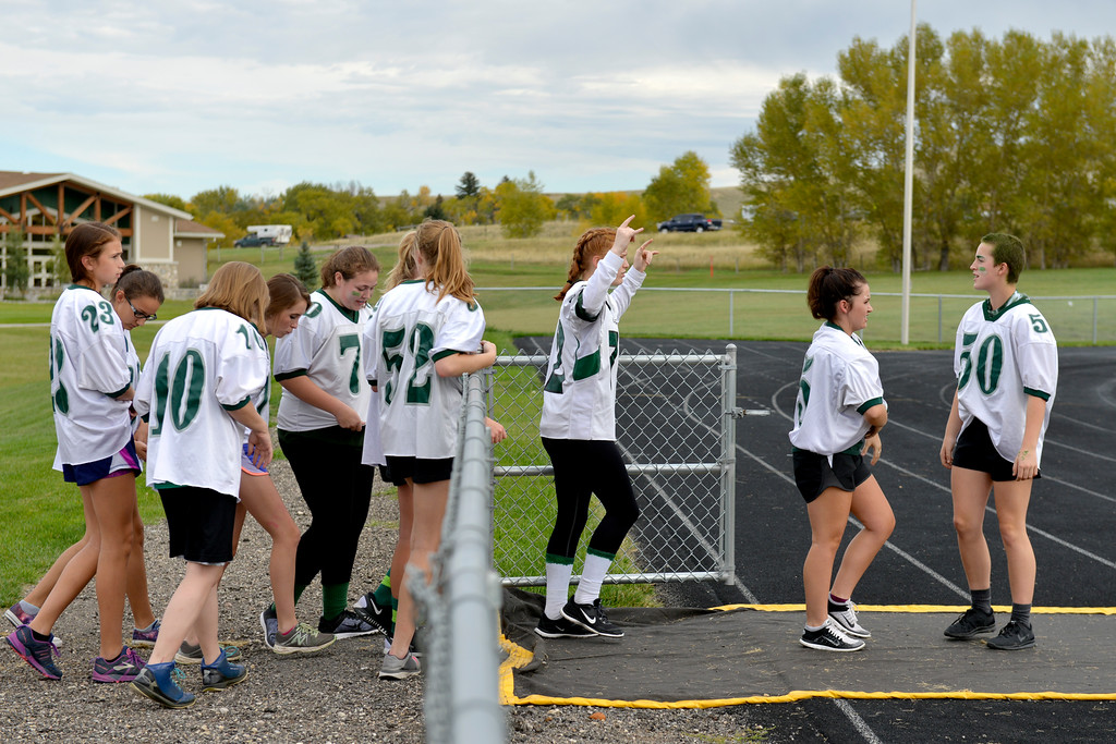 Justin Sheely   The Sheridan Press<br /> Freshmen/sophomore girls walk onto the field to faceoff the senior/junior players for powderpuff football Thursday at Tongue River High School. TRHS varsity volleyball plays Moorcroft at 4 p.m. and Eagles football plays Lusk at 7 p.m. Friday.