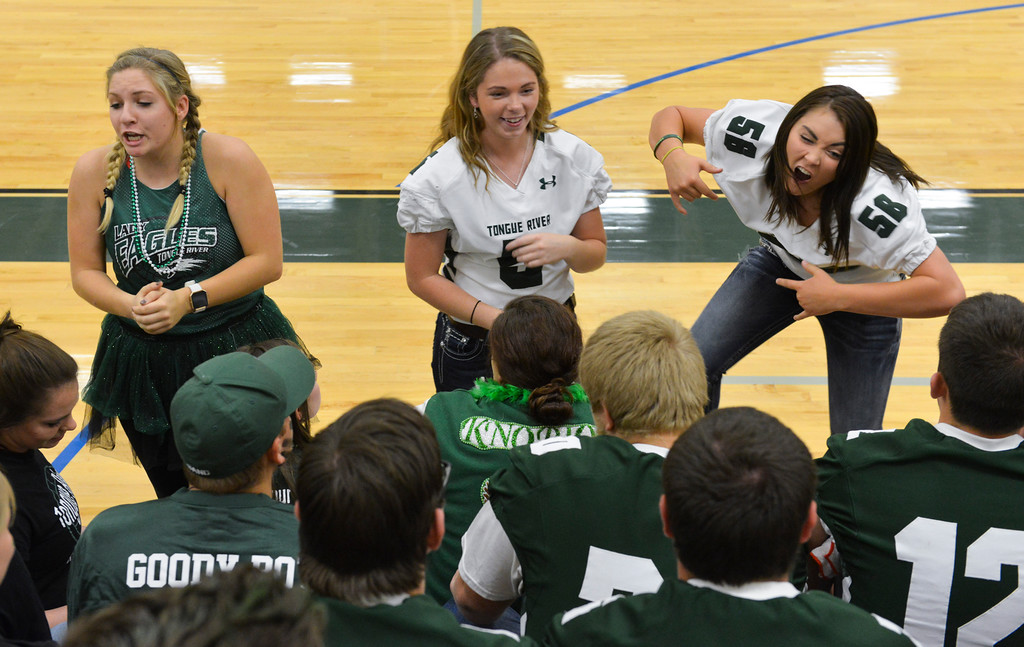 Justin Sheely   The Sheridan Press<br /> Seniors, from left, Kiley Carroll, Caylyn Dygon and Teghn Kobza hype up their classmates for a class cheer-off during the homecoming pep assembly last September at Tongue River High School.