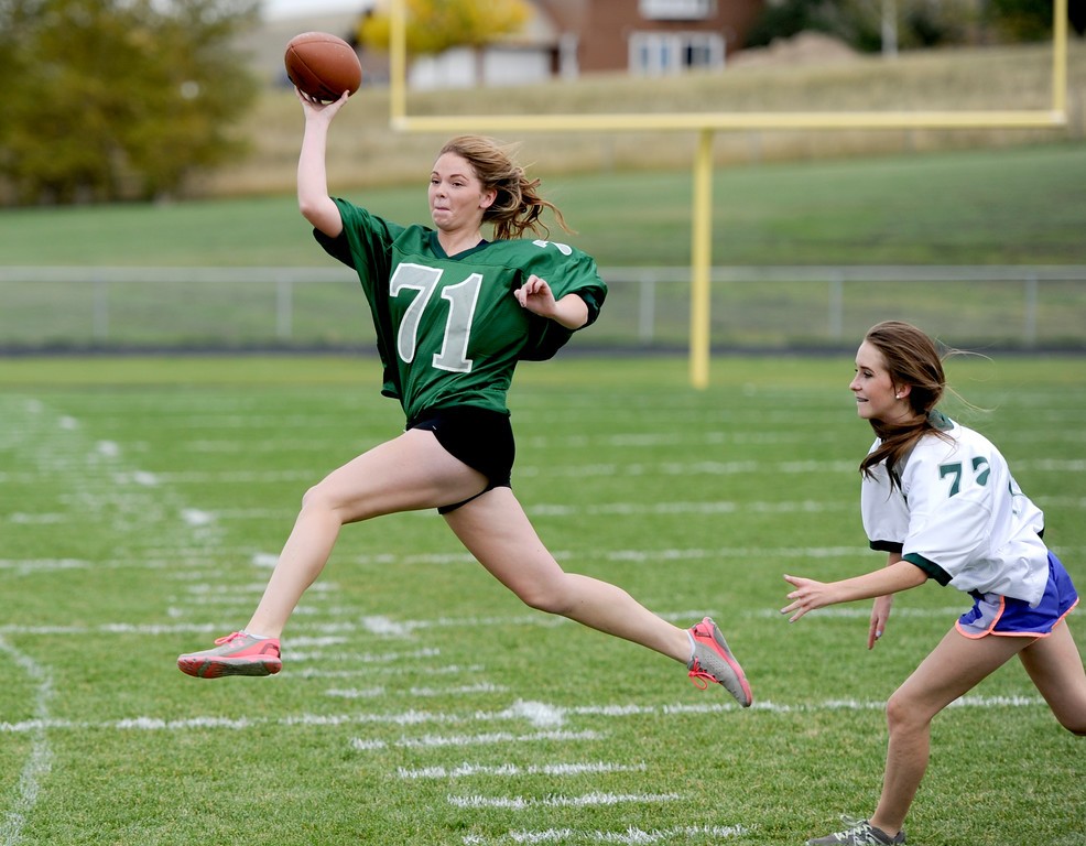 Justin Sheely | The Sheridan Press<br /> Senior Caylyn Dygon passes the ball against the freshmen/sophomores during powderpuff football Thursday at Tongue River High School. TRHS varsity volleyball plays Moorcroft at 4 p.m. and Eagles football plays Lusk at 7 p.m. Friday.