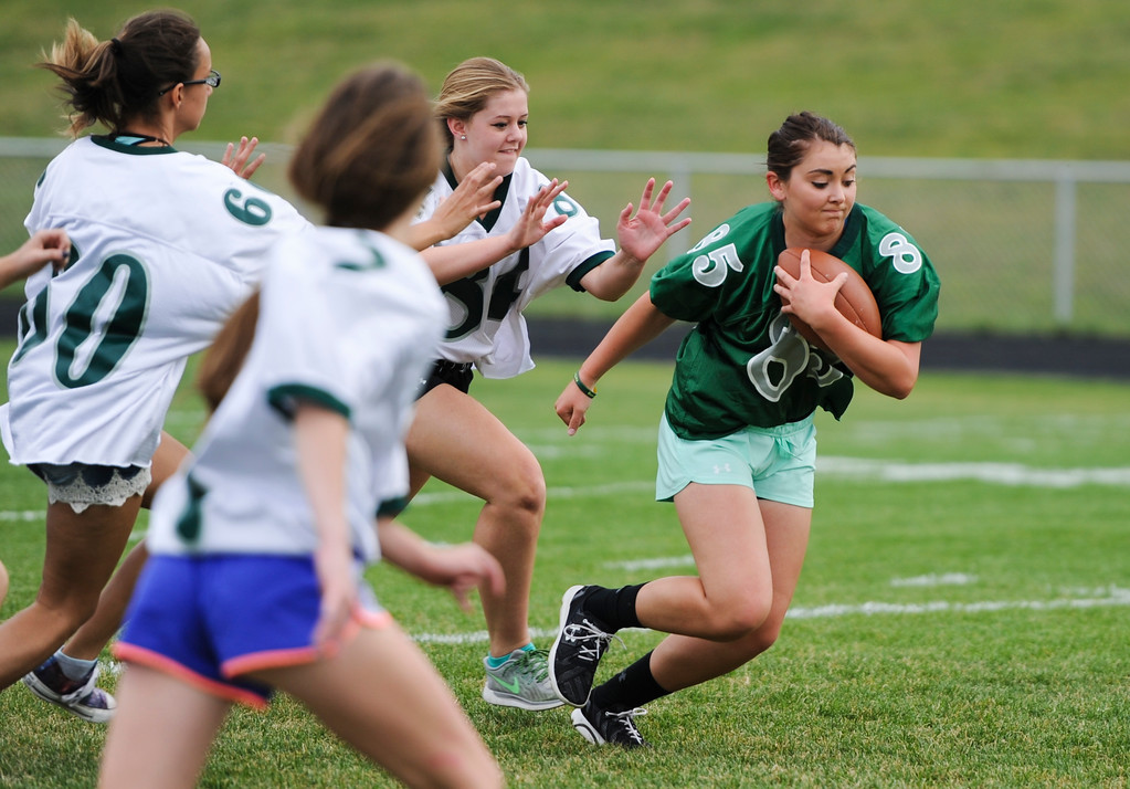Justin Sheely   The Sheridan Press<br /> Senior Teghn Kobza rushes against the freshmen/sophomores during powderpuff football Thursday at Tongue River High School. TRHS varsity volleyball plays Moorcroft at 4 p.m. and Eagles football plays Lusk at 7 p.m. Friday.