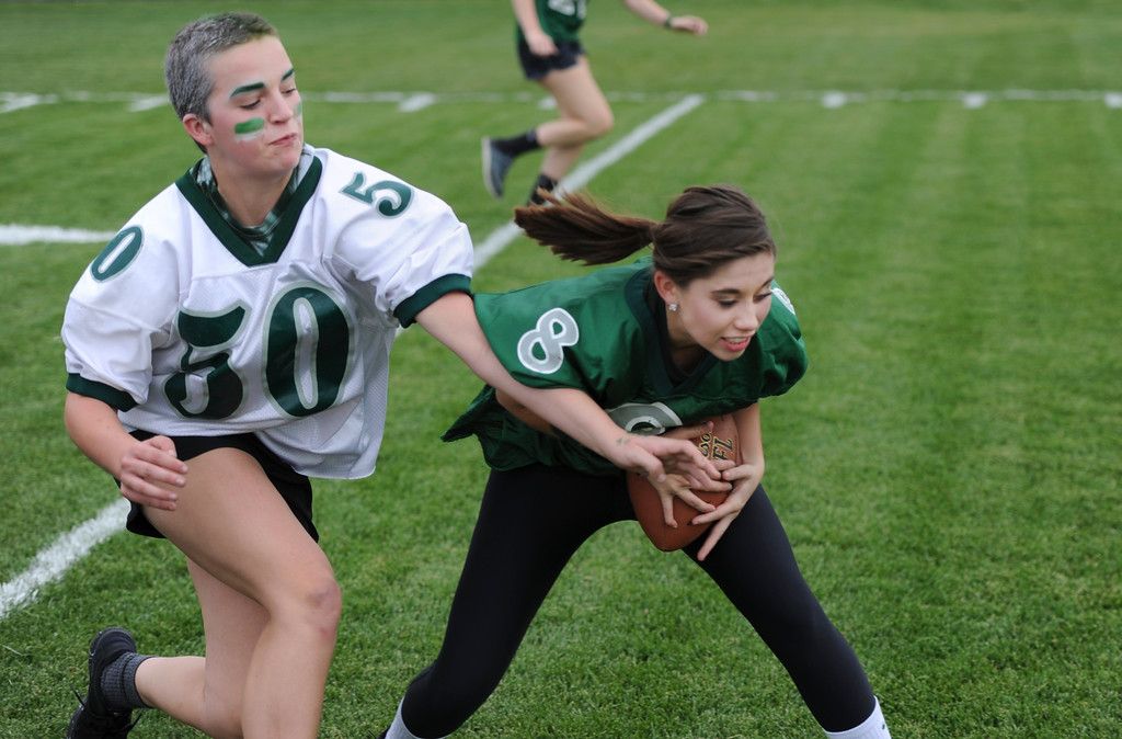 Justin Sheely | The Sheridan Press<br /> Freshman Kalli Aksamit, left, reaches out as Sierra McCoy, a senior, receives a pass during powderpuff football Thursday at Tongue River High School. TRHS varsity volleyball plays Moorcroft at 4 p.m. and Eagles football plays Lusk at 7 p.m. Friday.