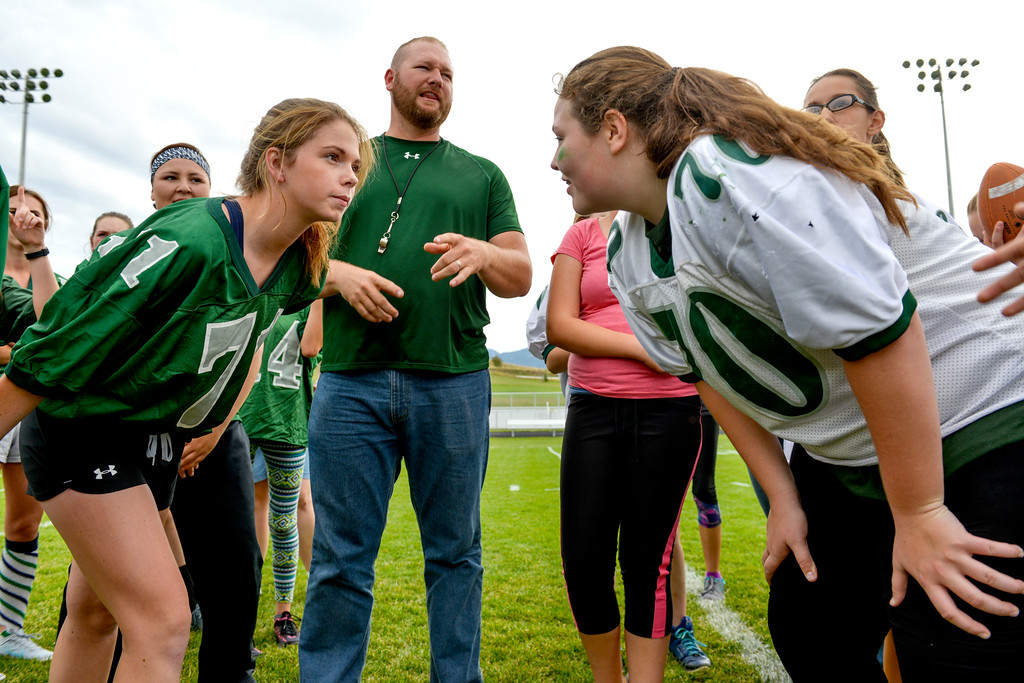 Justin Sheely   The Sheridan Press<br /> Senior Caylyn Dygon, left, and freshman Madi Miller face off as coach Steve Hansen officiates a coin toss for powderpuff football Thursday at Tongue River High School. TRHS varsity volleyball plays Moorcroft at 4 p.m. and Eagles football plays Lusk at 7 p.m. Friday.