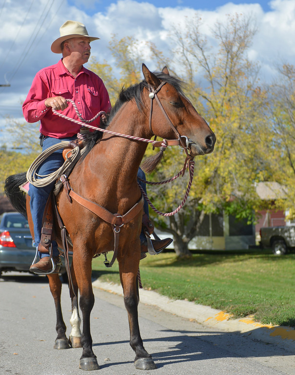 Justin Sheely | The Sheridan Press<br /> Tom Ogle sits on his horse as he watches the Tongue River High School Homecoming Parade on Friday in Dayton.