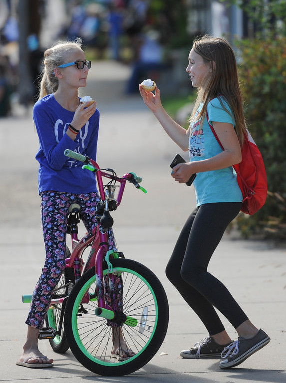 Justin Sheely   The Sheridan Press<br /> Twelve-year-olds Ridley David, left, and Chloe Wilson visit prior to the Tongue River High School Homecoming Parade on Friday in Dayton.