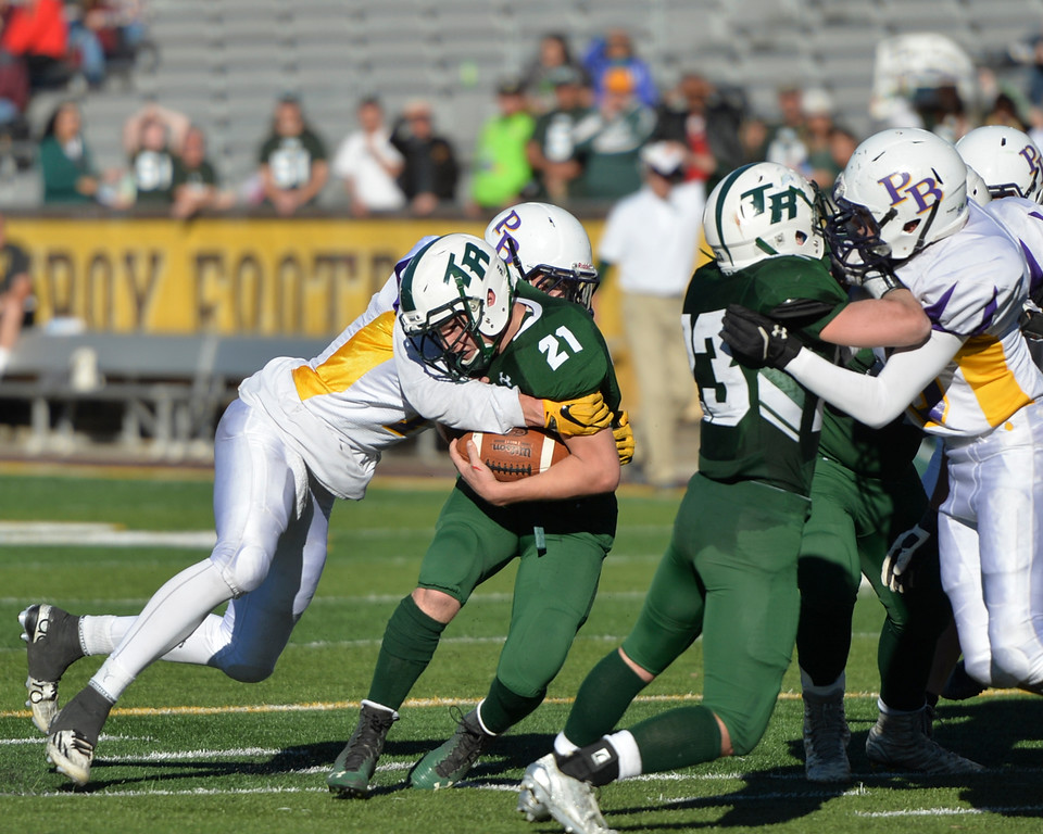 Justin Sheely | The Sheridan Press<br /> Tongue River's Matt Lobach is tackled by Pine Bluffs during the Class 1A State Championship Saturday at War Memorial Stadium in Laramie. The Eagles fell to the Hornets 10-7.