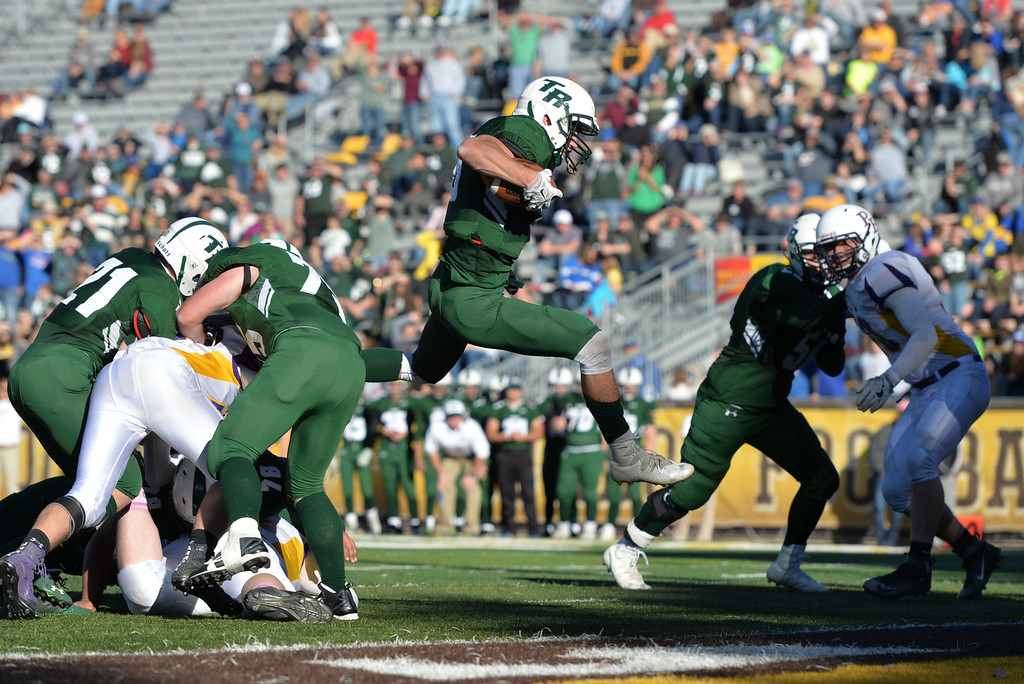 Justin Sheely | The Sheridan Press<br /> Tongue River's quarterback Brennan Kutterer keeps the ball for a touchdown run during the Class 1A State Championship Saturday at War Memorial Stadium in Laramie. The Eagles fell to the Hornets 10-7.