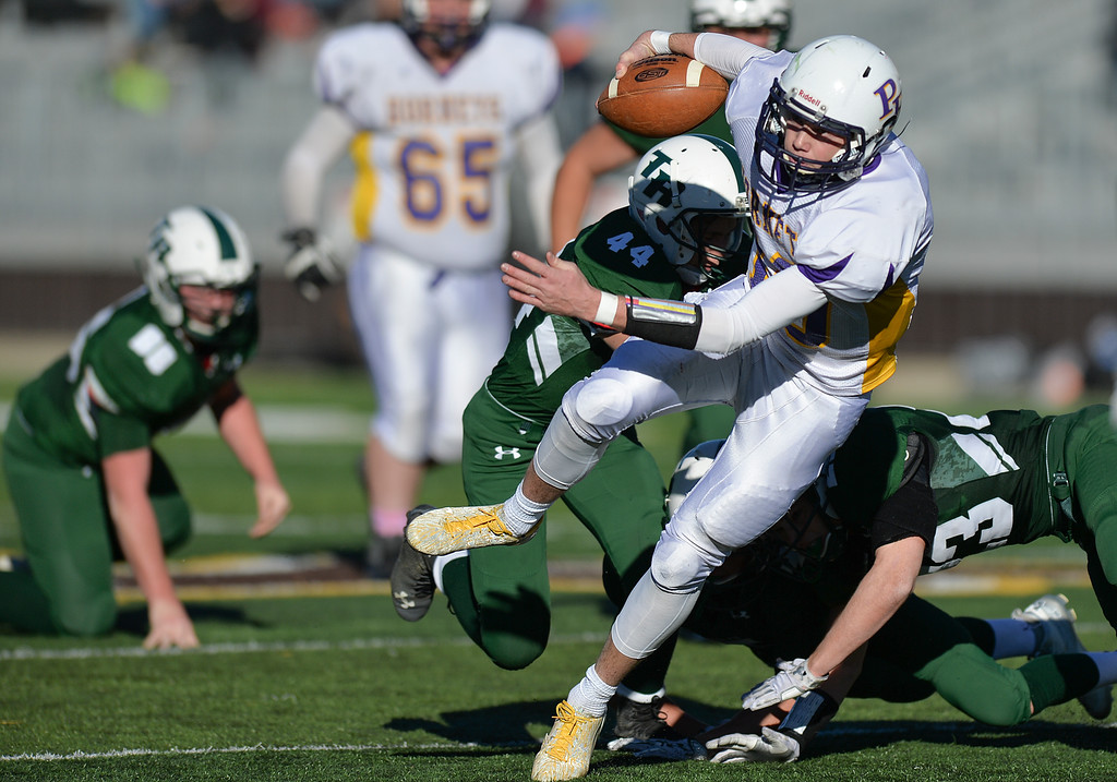 Justin Sheely | The Sheridan Press<br /> Tongue River just cannot stop Pine Bluffs' Haize Fornstrom on a rush during the Class 1A State Championship Saturday at War Memorial Stadium in Laramie. The Eagles fell to the Hornets 10-7.