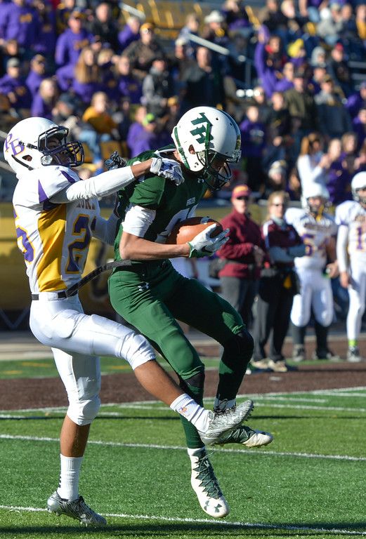 Justin Sheely | The Sheridan Press<br /> Tongue River's wide receiver Jay Keo catches the ball as a Pine Bluffs' Ishmael DePaulitte tackles during the Class 1A State Championship Saturday at War Memorial Stadium in Laramie. The Eagles fell to the Hornets 10-7.