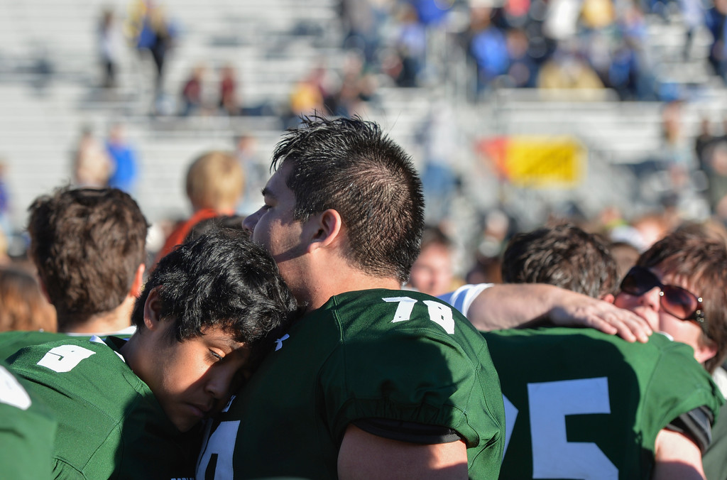Justin Sheely | The Sheridan Press<br /> Tongue River's Daien Bear Don't Walk, left, and Skyler Dillon-Bennett embrace after falling short of the state title during the Class 1A State Championship Saturday, Nov. 12 at War Memorial Stadium in Laramie. The Eagles fell to the Hornets 10-7.