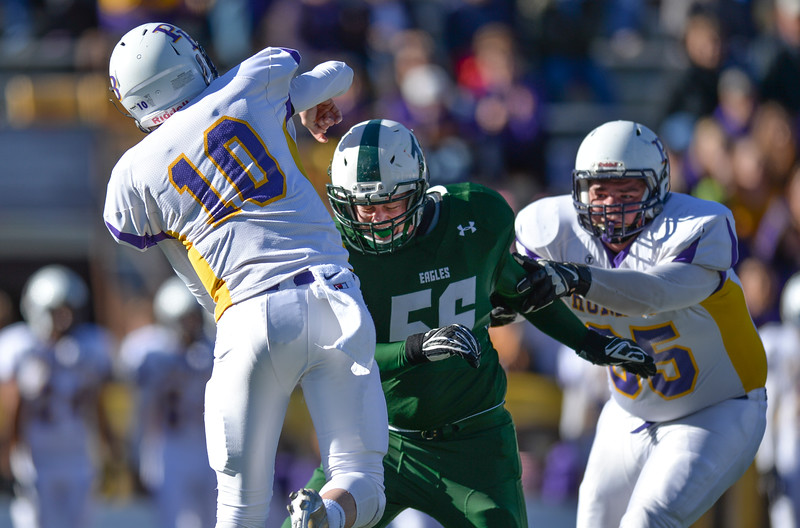 Justin Sheely | The Sheridan Press<br /> Tongue River's Mason Schroder tries to sack Pine Bluffs' quarterback Haize Fornstrom during the Class 1A State Championship Saturday at War Memorial Stadium in Laramie. The Eagles fell to the Hornets 10-7.