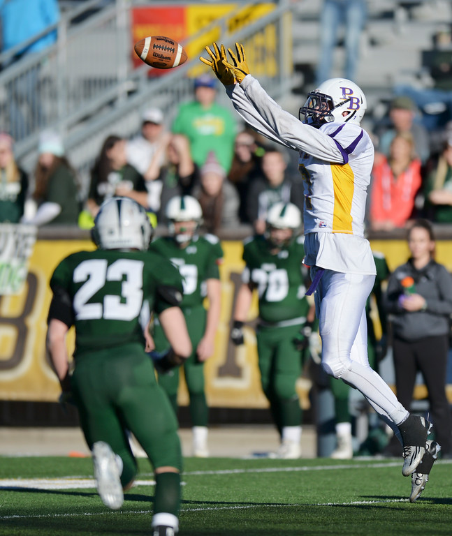 Justin Sheely | The Sheridan Press<br /> Pine Bluffs' six-foot-ten-inch wide receiver Hunter Thomas makes a catch against Tongue River during the Class 1A State Championship Saturday at War Memorial Stadium in Laramie. The Eagles fell to the Hornets 10-7.