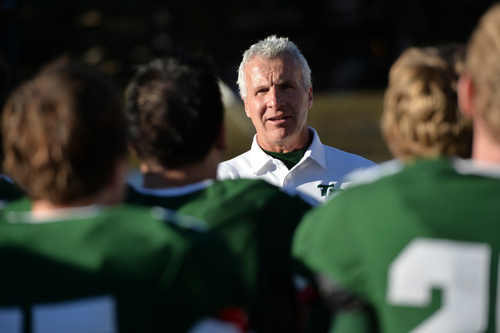 Justin Sheely | The Sheridan Press<br /> Tongue River's head coach John Scott speaks to his team at the end of the fourth quarter during the Class 1A State Championship Saturday at War Memorial Stadium in Laramie. The Eagles fell to the Hornets 10-7.