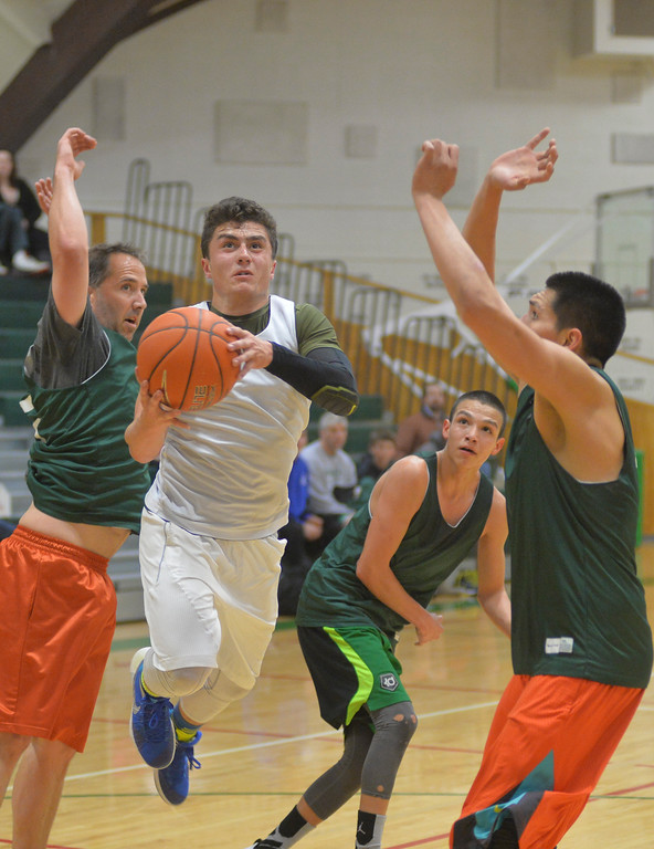 Justin Sheely | The Sheridan Press<br /> Team For The People's Matt Willey drives the ball against Tongue River during adult league basketball Wednesday at the Tongue River Valley Community Center in Dayton. Tongue River won 116 - 47.