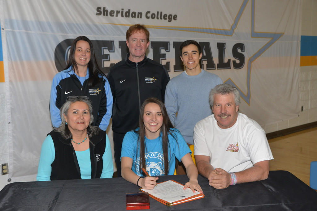 Justin Sheely | The Sheridan Press<br /> Parkman native and Lady Generals basketball player Sarah Rawlings signs on with South Dakota School of Mines Wednesday in the Golden Dome at Sheridan College. Back row, from left, Lady Generals assistant coach Amy McCarthy, head coach Frank McCarthy and Henry Rawlings. Sarah Rawlings mother Steffie Rawlings, left, and father Dave Rawlings. Rawlings will be pursuing a degree in civil engineering and will play for the Hardrocker women's basketball 2016-2017 season.