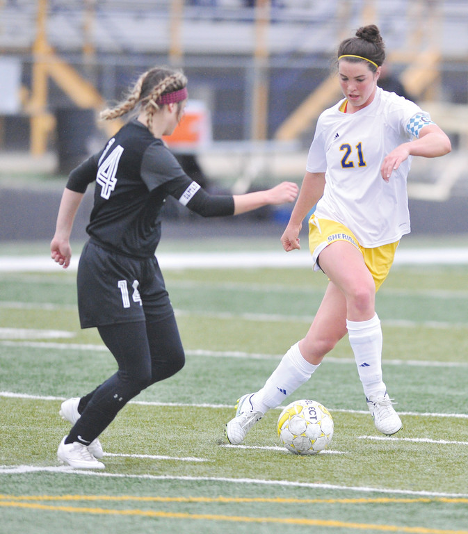 Mike Dunn | The Sheridan Press. <br /> Robbi Ryan, right, dribbles around a Cheyenne South defender Saturday morning at Homer Scott Field. The Lady Broncs beat Cheyenne South 4-1.