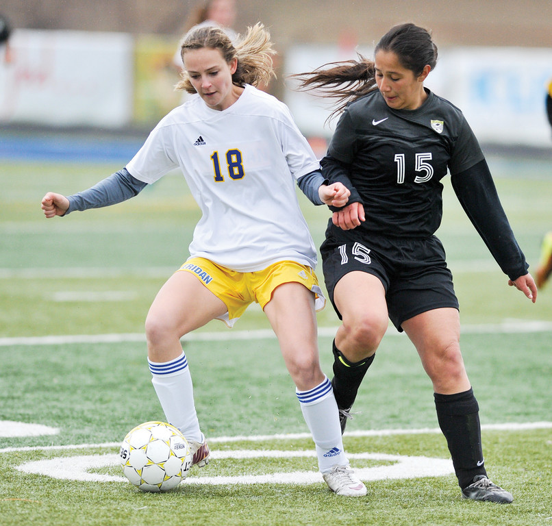Mike Dunn | The Sheridan Press. <br /> Cassidy Schellinger, left, fights off a Cheyenne South defender Saturday morning at Homer Scott Field. The Lady Broncs beat Cheyenne South 4-1.