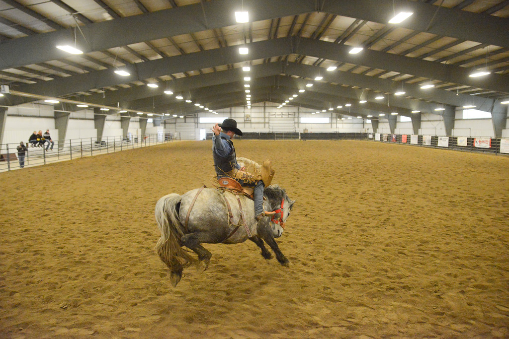 Justin Sheely | The Sheridan Press<br /> Sheridan College Rodeo Athlete Tate Clark rides saddle bronc during the last practice week of the season Tuesday at the Sheridan College AgriPark. Sheridan College rodeo athletes will be heading to their last rodeo this weekend in Laramie.
