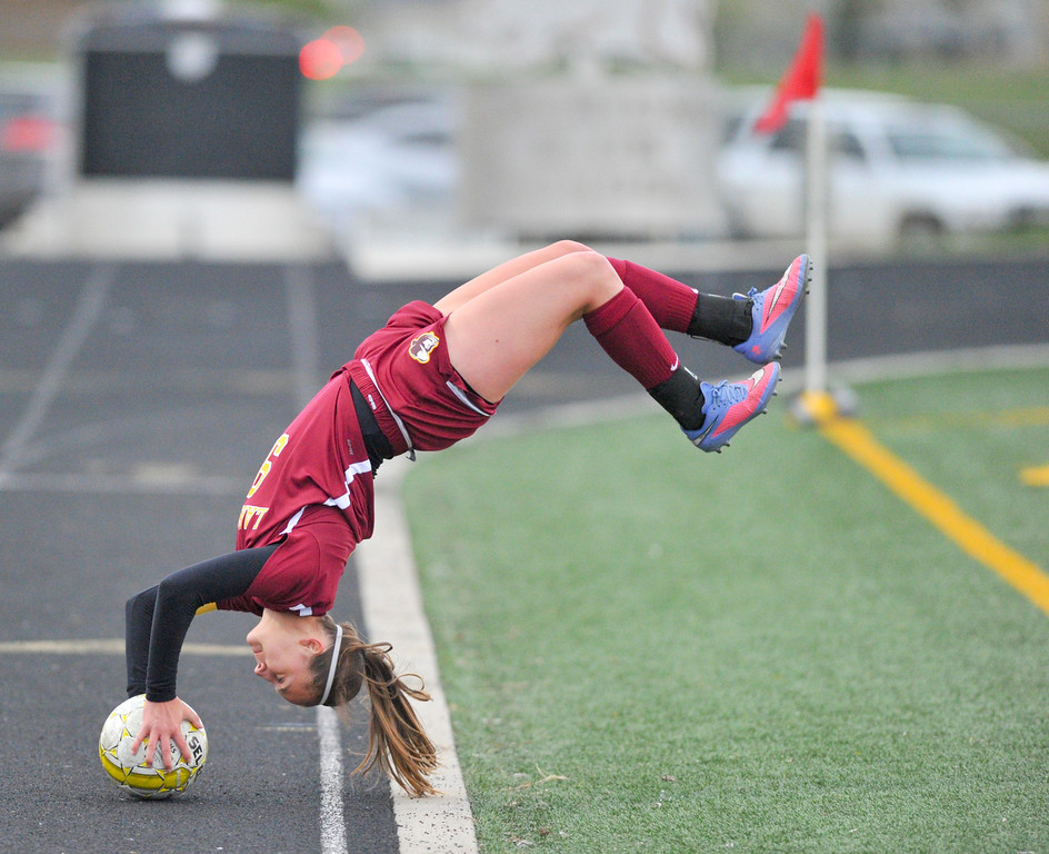 Jaqui Pulley, of Laramie, does a flip throw Friday against the Sheridan Lady Broncs. Mike Dunn | The Sheridan Press.