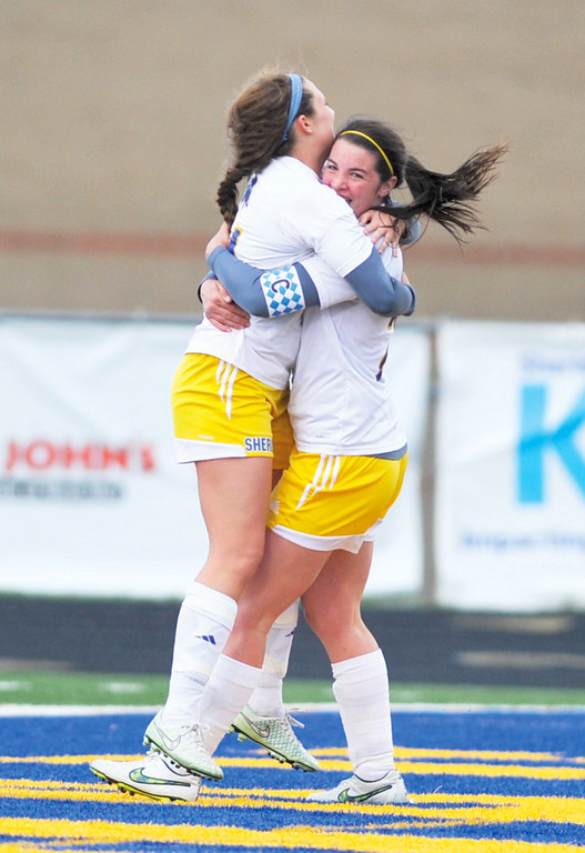 Mike Dunn | The Sheridan Press <br /> Robbi Ryan, right, embrasses her teammate Jamy Shassetz after Ryan's first goal Monday at Homer Scott Field. The Lady Broncs beat Buffalo 3-0.
