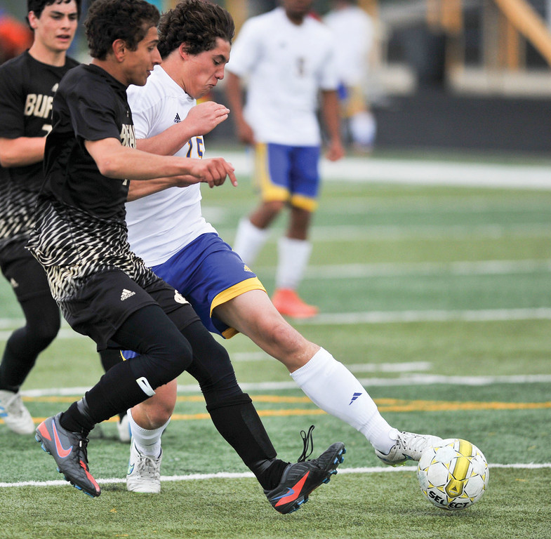 Riley Sessions, right, fights off a defender Monday at Homer Scott Field. The Broncs fell to Buffalo 1-0.