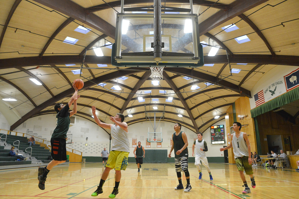 Justin Sheely | The Sheridan Press<br /> Team Tongue River, green, shoots against For The People during adult league basketball Wednesday at the Tongue River Valley Community Center in Dayton. Tongue River won 116 - 47.