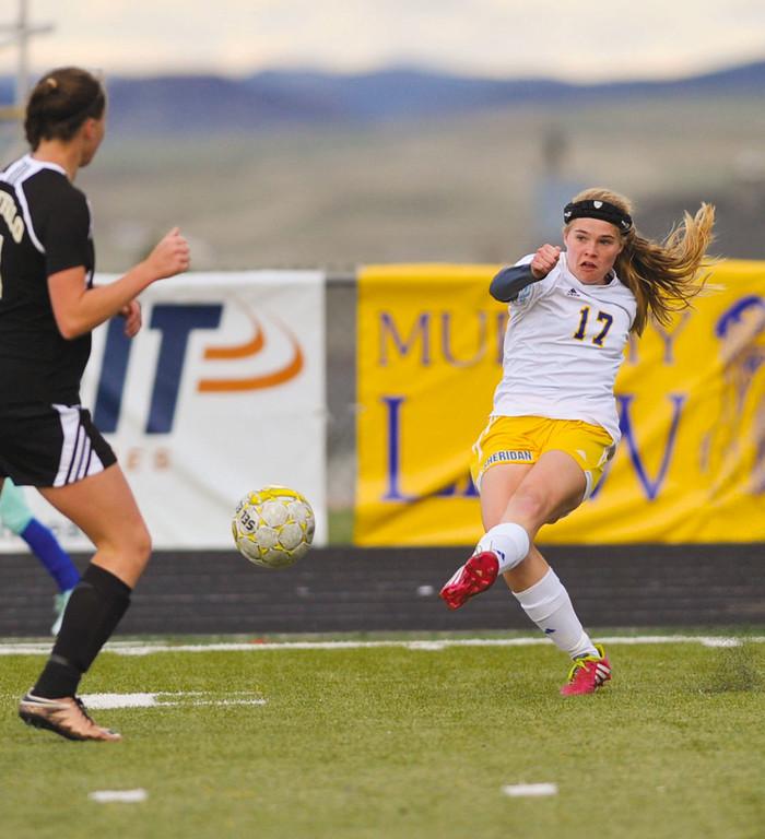 Katelynn Brooks, right, kicks the ball down field Monday at Homer Scott Field. The Lady Broncs beat Buffalo 3-0.
