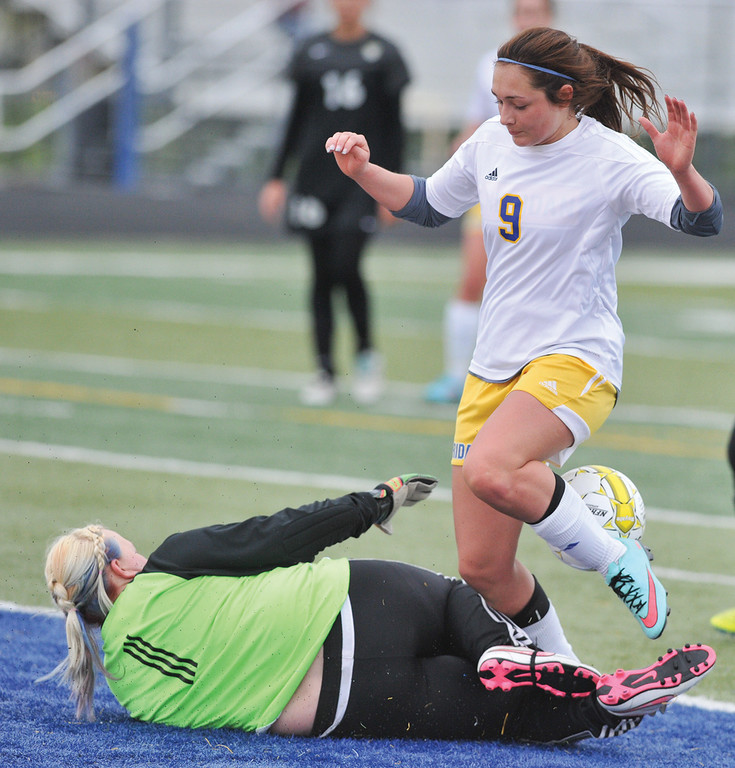 Mike Dunn | The Sheridan Press.<br /> Kirsten Hendricks, right, gets tripped up by Cheyenne South's keeper Saturday morning at Homer Scott Field. The Lady Broncs beat Cheyenne South 4-1.