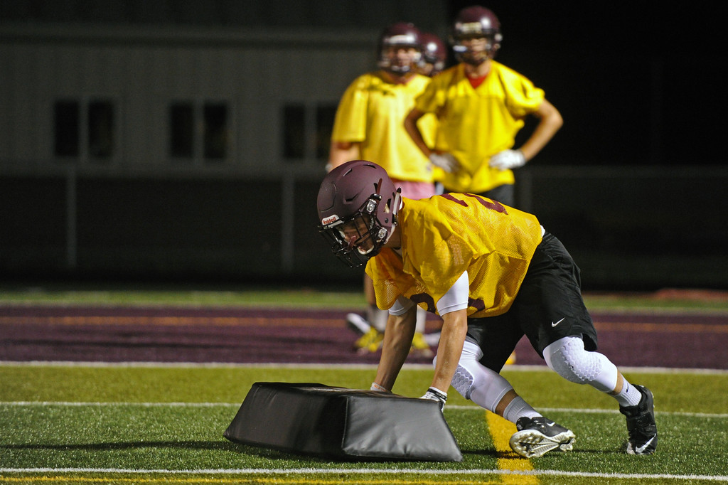 Colton Bates pushes a pad up the field during Big Horn High School's midnight football practice on Monday, August 15. Monday marked the first official practice day of the season for Big Horn and its 2A opponents. Mike Pruden | The Sheridan Press