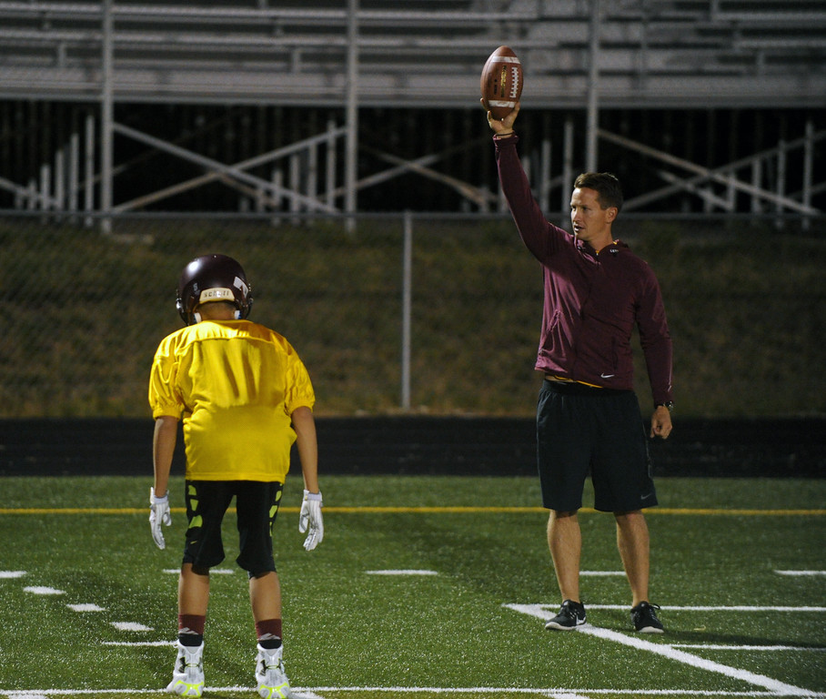 Assistant coach Colter Brantz, right, instructs defensive backs in a footwork drill during Big Horn High School's midnight football practice on Monday, August 15. Monday marked the first official practice day of the season for Big Horn and its 2A opponents. Mike Pruden | The Sheridan Press