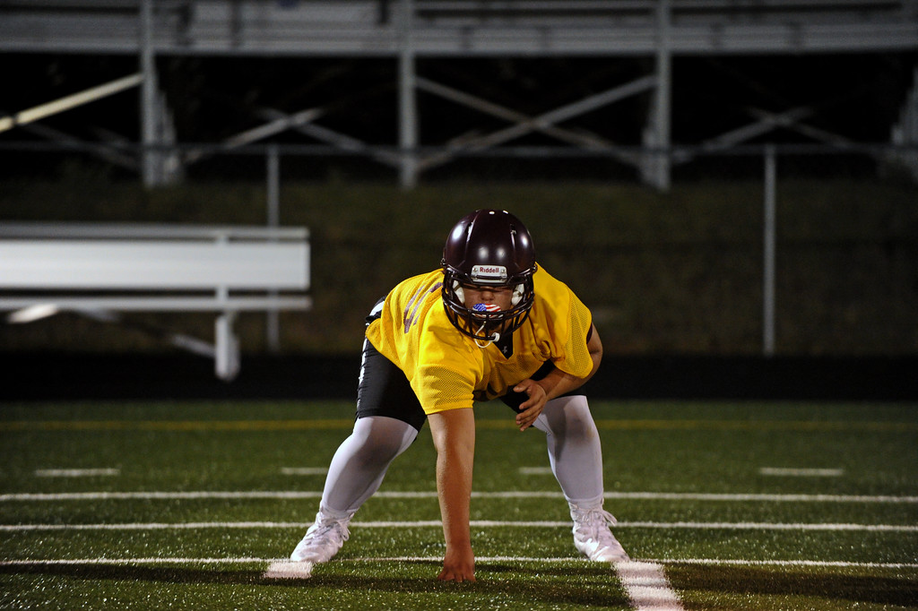 Lineman Jaxon Parker works on his three-point stance during Big Horn High School's midnight football practice on Monday, August 15. Monday marked the first official practice day of the season for Big Horn and its 2A opponents. Mike Pruden | The Sheridan Press