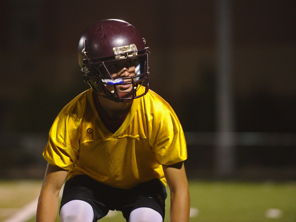 Big Horn's Kade Vandyken lines up for a backpeddling drill during the Rams' midnight practice on Monday, Aug. 15 at Big Horn High School. Mike Pruden | The Sheridan Press