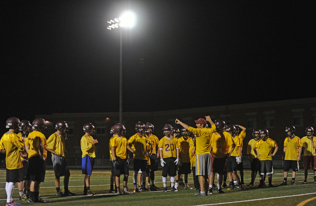 The Big Horn High School football team lines up before a drill under the lights during the Rams' annual midnight practice on Monday, August 15. Monday marked the first official practice day of the season for Big Horn and its 2A opponents. Mike Pruden | The Sheridan Press