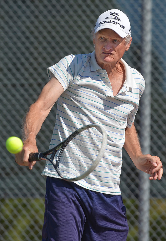 Justin Sheely | The Sheridan Press<br /> Bob Elmore hits the ball during the Mullinax Tennis Doubles tournament Saturday at Sheridan High School.