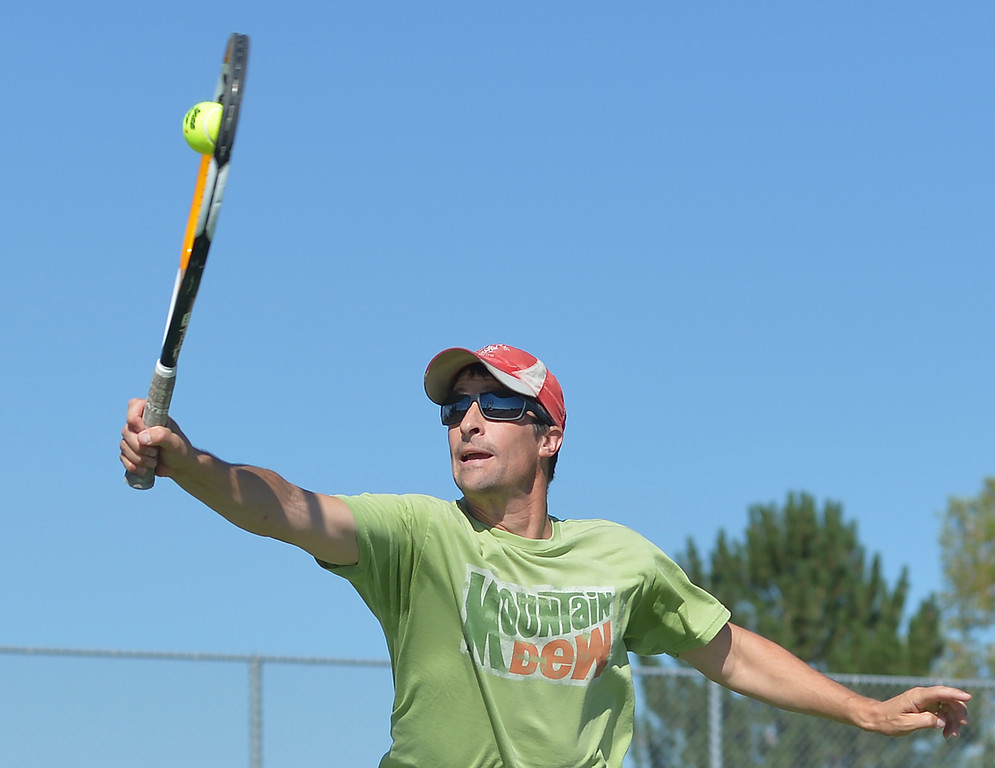 Justin Sheely | The Sheridan Press<br /> Mark Rogaczewski extends to hit the ball during the Mullinax Tennis Doubles tournament Saturday at Sheridan High School.